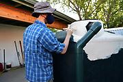 Michael primes my cistern with elastomeric coating.