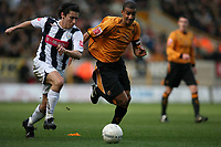 Photo: Rich Eaton.<br /> <br /> Wolverhampton Wanderers v West Bromwich Albion. The FA Cup. 28/01/2007. Wolves captain Karl Henry right chases down Robert Koren of West Brom