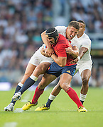 Twickenham, England.  Sam BURGESS assisted by Antony WATSON hang onto Alexandre DUMOULIN, during the QBE International. England vs France [World cup warm up match]  Saturday.  15.08.2015,  [Mandatory Credit. Peter SPURRIER/Intersport Images].