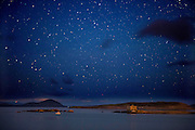 Perseid Meteor Shower Ireland. Ballinskelligs Dark Sky Reserve Ireland. A nocturnal view of the night sky looking into the South West over McCarthy's Castle and Horse Island on Ballinskelligs Beach in County Kerry taken in the early hours of Saturday morning.  The area is the only designated Gold Tier International Dark-Sky Reserve in the Northern Hemisphere and only three exist in the world.  Hundreds of astronomers travel from all over the world to view the night sky from South Kerry taken during the August Persied shooting star phenonenon.(perseids)<br /> On clear nights many astronomical sights can be seen with the naked eye including the beautiful band of the Milky Way, the Andromeda Galaxy, Star Clusters and Nebula's without the aid of any astronomical equipment or filters. The South Kerry astronomy group based in Waterville have regular events and classes in astronomy.<br /> Picture by Don MacMonagle<br /> <br /> Technical details:<br /> <br /> info@macmonagle.com