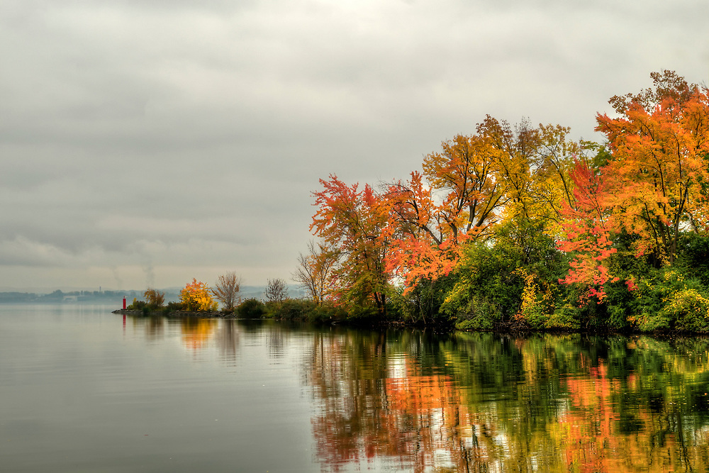 Fall colors surround Willow Bay at Onondaga Lake Park in Liverpool, NY on Monday, October 17, 2016. Copyright 2016 Jason Barnette