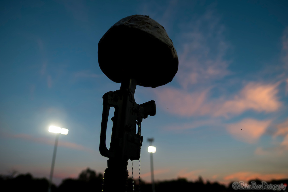A military helmet and rifle stand at attention as part of the Honor Bowl ceremony before the game as the Del Oro Golden Eagles varsity football team host the Oak Ridge Trojans, Friday Oct 21, 2016.<br /> photo by Brian Baer