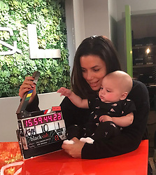 """Eva Longoria releases a photo on Twitter with the following caption: """"""""I think we found our next director @blackishabc! #BabyBaston"""""""". Photo Credit: Twitter *** No USA Distribution *** For Editorial Use Only *** Not to be Published in Books or Photo Books ***  Please note: Fees charged by the agency are for the agency's services only, and do not, nor are they intended to, convey to the user any ownership of Copyright or License in the material. The agency does not claim any ownership including but not limited to Copyright or License in the attached material. By publishing this material you expressly agree to indemnify and to hold the agency and its directors, shareholders and employees harmless from any loss, claims, damages, demands, expenses (including legal fees), or any causes of action or allegation against the agency arising out of or connected in any way with publication of the material."""