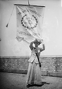 Failure Is Impossible. Susan B. Anthony. Votes for Women 1913. Photo shows suffragist Florence Jaffray 'Daisy' Harriman  holding a banner with the words 'Failure Is Impossible. Susan B. Anthony. Votes for Women'