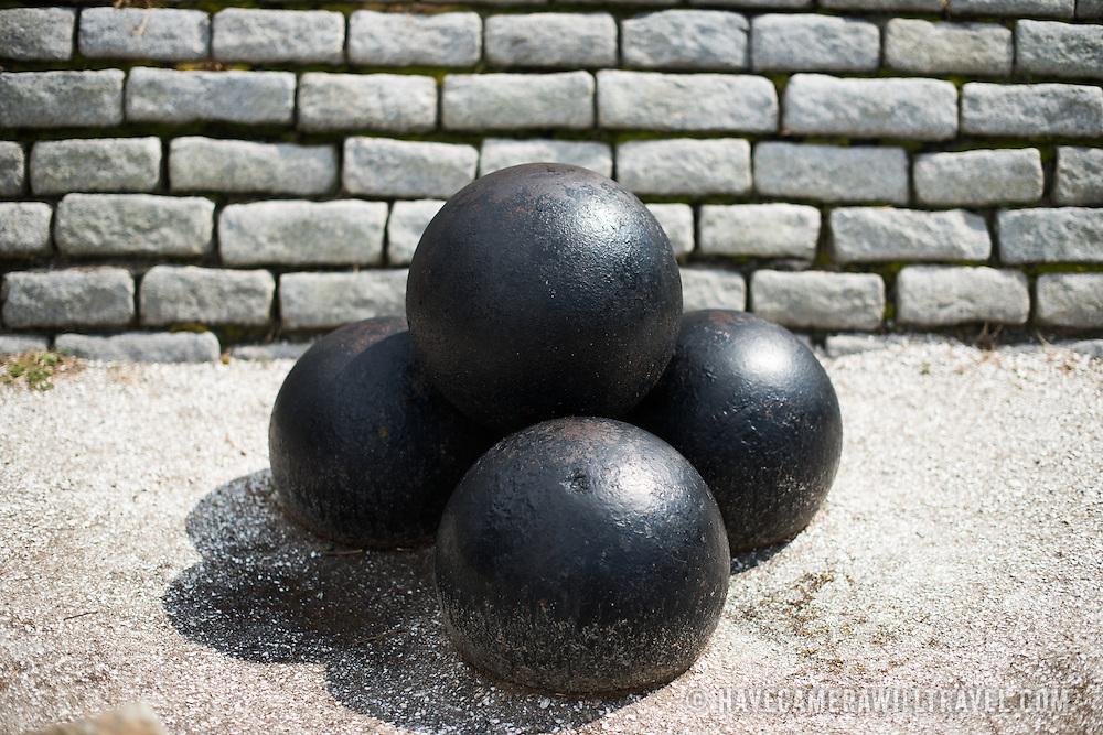 SULLIVAN'S ISLAND, South Carolina - 15-inch Rodman Smoothbore cannonballs used during the period 1873-1898. Fort Moultrie is part of the Fort Sumter National Monument at the entrance to Charleston Harbor in South Carolina. The fort has played a crucial role in defending the harbor from the time of the Revolutionary War through World War II. During that time it has undergone multiple upgrades, from the original palmetto log walls to the newer heavily fortified earthen bunkers.