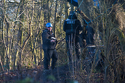 Harefield, UK. 18 January, 2020. Enforcement agents acting for HS2 monitor a site containing the Colne Valley wildlife protection camp from which all but two Stop HS2 activists were evicted last week. Activists from Stop HS2, Save the Colne Valley and Extinction Rebellion are holding a three-day 'Stand for the Trees' event in the Colne Valley timed to coincide with tree felling work by HS2. 108 ancient woodlands are set to be destroyed by the high-speed rail link.