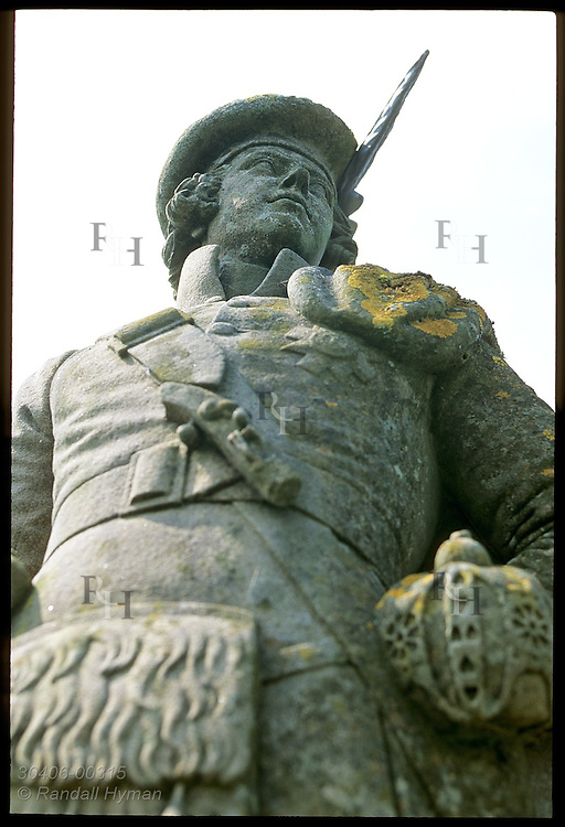 Statue of Highlander tops the Glenfinnan Monument on Loch Shiel honoring Jacobite rebellion of 1745; Glenfinnan, Scotland.