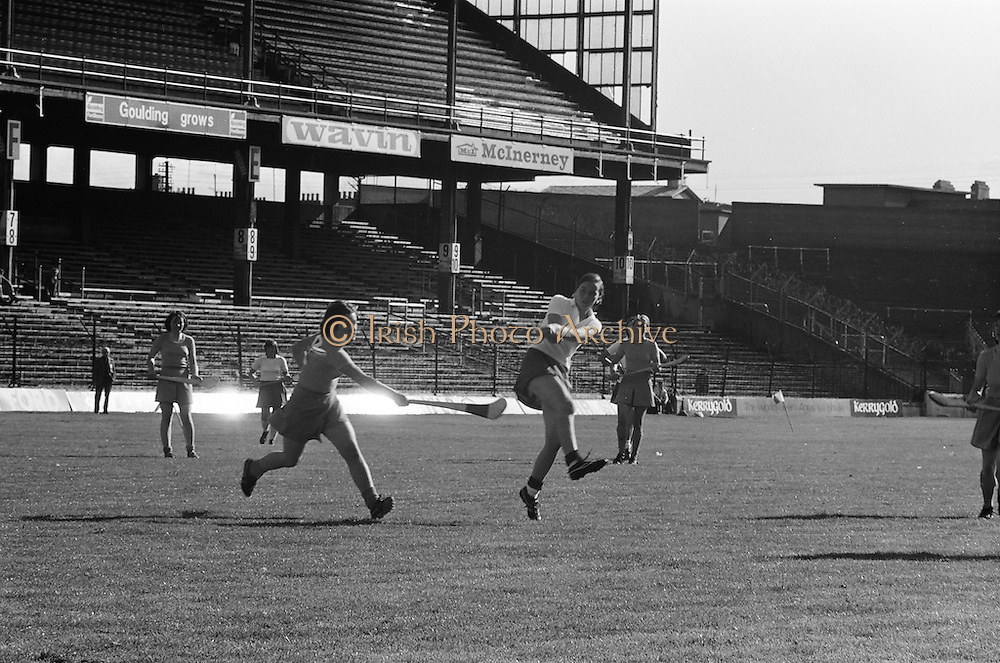 Wexford hits the ball towards the goal as Cork blocks her during the All Ireland Senior Camogie Final Cork v Wexford in Croke Park on the 21st September 1975. Wexford 4-3 Cork 1-2.