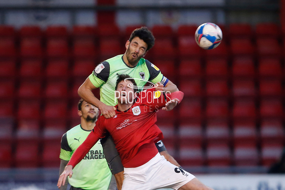 Will Nightingale of AFC Wimbledon heads clear during the EFL Sky Bet League 1 match between Crewe Alexandra and AFC Wimbledon at Alexandra Stadium, Crewe, England on 23 January 2021.