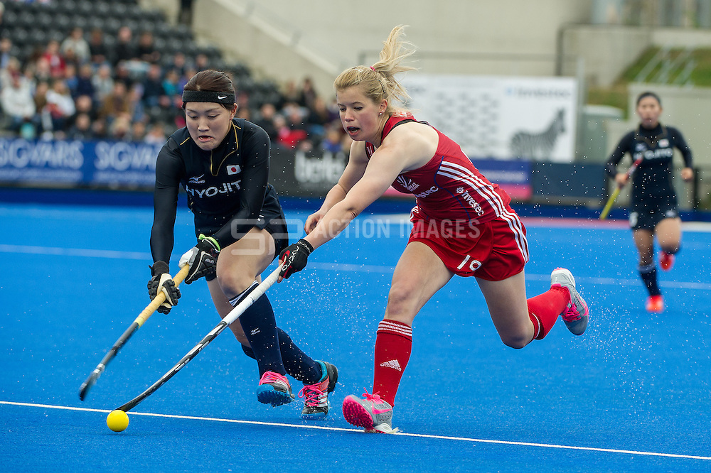 Great Britain's Sophie Bray is tackled by Maki Sakaguchi of Japan. Great Britain v Japan - Investec Private Banking International, Lee Valley Hockey & Tennis Centre, London, UK on 26 April 2015. Photo: Simon Parker
