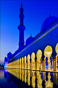 """One of the world's largest mosques, the Sheikh Zayed Grand Mosque in Abu Dhabi can accommodate more than 40,000 worshippers. In 2017, authorities ceremonially renamed the mosque after the mother of Jesus Christ  Mariam, Umm Eisa or Arabic for """"Mary, the mother of Jesus."""" Sheikh Mohammed Bin Zayed Al Nahyan, crown prince of Abu Dhabi, says he ordered the change to build bridges to other religions.  © Steve Raymer / National Geographic Creative"""