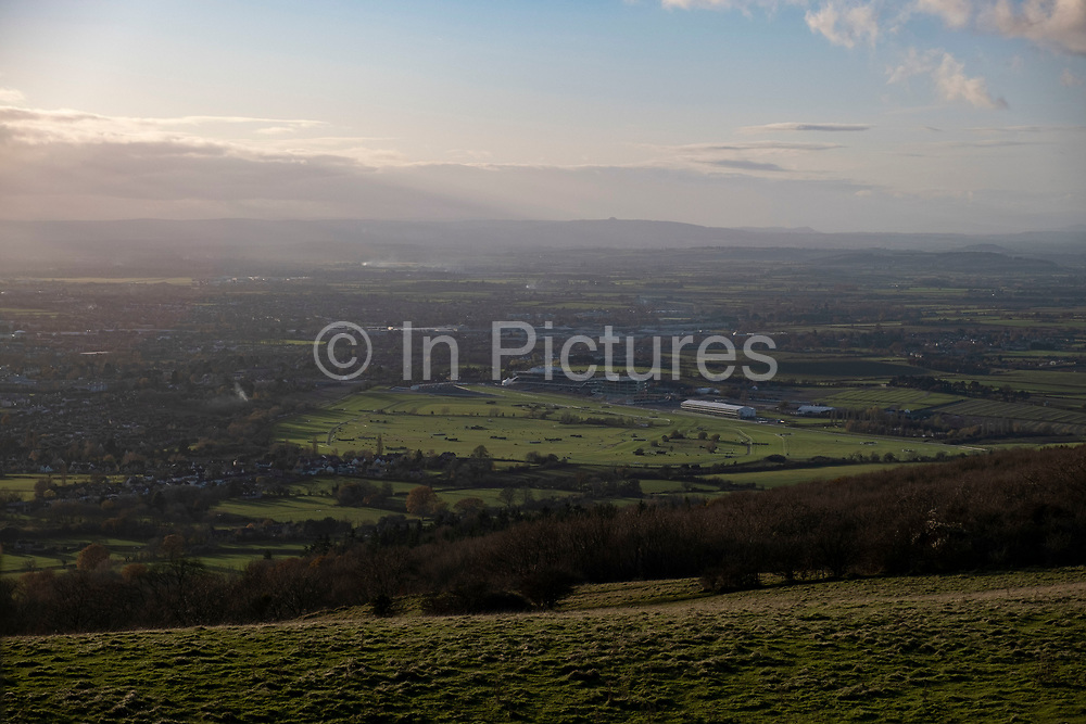 Distant view of Cheltenham Racecourse from Cleve Hill on 22nd November 2020 in Cheltenham, United Kingdom. Cheltenham Racecourse at Prestbury Park, near Cheltenham, Gloucestershire, hosts National Hunt horse racing. Its most prestigious meeting is the Cheltenham Festival, held in March, which features several Grade I races including the Cheltenham Gold Cup.