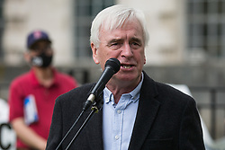 London, UK. 3rd July, 2021. John McDonnell, Labour MP for Hayes and Harlington, addresses NHS workers and supporters at a protest rally opposite Downing Street as part of a national day of action to mark the 73rd birthday of the National Health Service. The protesters called for fair pay for NHS workers, for better funding of the NHS and for an end to privatisation measures affecting the NHS.