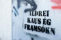 "Painted text on a house in 101 Reykavík. ""I never voted for the Progressive Party"" the text reads. Málaður texti á spennuboxi í 101 Reykjavík. Aldrei kaus ég framsókn."