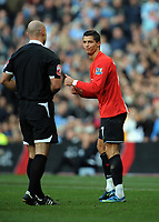 Cristiano Ronaldo applauds Referee Howard Webb after his 1st yellow card<br /> Manchester United 2008/09<br /> Manchester City V Manchester United (0-1) 30/11/08<br /> The Premier League<br /> Photo Robin Parker Fotosports International
