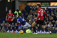 Marouane Fellaini  of Manchester Utd clatters/fouls Idrissa Gueye of Everton who falls in the penalty box and a penalty is awarded late in the game..Premier league match, Everton v Manchester United at Goodison Park in Liverpool, Merseyside on Sunday 4th December 2016.<br /> pic by Chris Stading, Andrew Orchard sports photography.