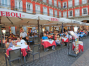 Cafe restaurant bars tables outside Plaza Mayor, Madrid city centre, Spain