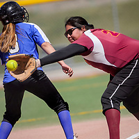 Rehoboth Lynx Gabi Barton (25) makes the catch as Navajo Pine Warrior Mariah Yazzie (3) tags first base Thursday at Ford Canyon Park in Gallup.