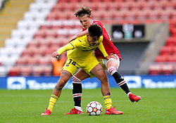 Villarreal's Aitor Gelardo (left) and Manchester United's Charlie Savage battle for the ball during the UEFA Youth League, Group F match at Leigh Sports Village, Manchester. Picture date: Wednesday September 29, 2021.