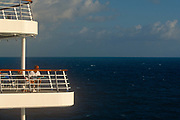 Passengers enjoy the sea view from their vacation ships deck on 15th May 1996, aboard the Carnival cruise ship Ecstasy, off the Gulf of Mexico, USA.