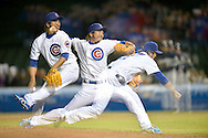 In this photo taken using the multiple exposure setting on the camera, closer Kyuji Fujikawa #11 of the Chicago Cubs delivers during the ninth inning against the Milwaukee Brewers on April 9, 2012 at Wrigley Field in Chicago, Illinois. The Cubs defeated the Brewers 6-3.    (Getty Images)