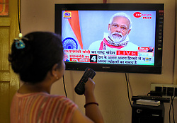 April 14, 2020, Kolkata, India: Indian Prime Minister Narendra Modi seen on television announcing an extension of the lockdown up to 3rd May as a preventive measure against the spread of Coronavirus. India has confirmed 10,200 coronavirus cases and 330 deaths. (Credit Image: © Avishek Das/SOPA Images via ZUMA Wire)