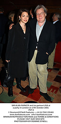 SIR ALAN PARKER and his partner LISA at a party to celebrate the publication of his book The Sucker's Kiss held at Dick's Bar, 20 Glasshouse Street, London on 27th October 2003.