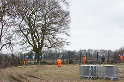 Great Missenden, UK. 18th March, 2021. Security guards protect works to fell a row of hundred-year-old oak trees in Leather Lane in connection with the HS2 high-speed rail link. Almost 40,000 people have recently signed a petition calling for the trees lining the ancient country lane not to be felled to make way for a temporary haul road and construction compound and local residents and conservationists have accused HS2 contractors of destroying active bird boxes on the site.
