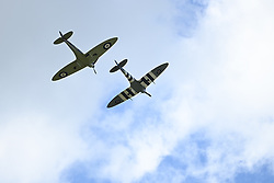 © Licensed to London News Pictures. 10/07/2020. London, UK. A spitfire and a hurricane flypast over the town of Ditchling, East Sussex, ahead of the funeral of Dame Vera Lynn. The 'Forces' Sweetheart', who died last month aged 103, was famous for singing performances during WW2, which helped raise morale amongst troops abroad. Photo credit: Ben Cawthra/LNP
