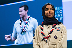© Licensed to London News Pictures . 03/10/2017 . Manchester , UK . Chief Scout BEAR GRYLLS and FERDOUS AL-AUDHALI (22 from Solihull) on stage ahead of the Home Secretary , during day three of the Conservative Party Conference at the Manchester Central Convention Centre . Photo credit : Joel Goodman/LNP