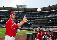 C.J. Cron signs autographs before the Angels' preseason game against the Chicago Cubs at Angel Stadium Sunday.<br /> <br /> <br /> ///ADDITIONAL INFO:   <br /> <br /> angels.0404.kjs  ---  Photo by KEVIN SULLIVAN / Orange County Register  --  4/3/16<br /> <br /> The Los Angeles Angels take on the Chicago Cubs at Angel Stadium during a preseason game at Angel Stadium Sunday.<br /> <br /> <br />  4/3/16