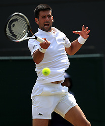 Novak Djokovic in action against Adam Pavlasek on day four of the Wimbledon Championships at The All England Lawn Tennis and Croquet Club, Wimbledon.