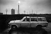 Dog left in parked car, Neasden, London. Coming and Going is a project commissioned by the Museum of London for photographer Barry Lewis in 1976 to document the transport system as it is used by passengers and commuters using public transport by trains, tubes and buses in London, UK.