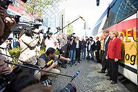 21 AUG 2008, BERLIN/GERMANY:<br /> Ronald Pofalla (L), CDU Generalsekretaer, und Angela Merkel (R), CDU, Bundeskanzlerin, und Journalisten vor dem Tourbus, Auftaktveranstaltung zur Dialog-Tour des CDU Generalsekretaers, Konrad-Adenauer-Haus<br /> IMAGE: 20080821-01-030<br /> KEYWORDS: camera, Kamera