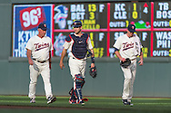 Joe Mauer #7, Kevin Correia #30, and Rick Anderson #40 of the Minnesota Twins walk to the dugout before a game against the Chicago White Sox on June 19, 2013 at Target Field in Minneapolis, Minnesota.  The Twins defeated the White Sox 7 to 4.  Photo: Ben Krause