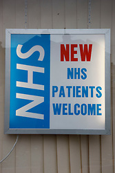 Sign at dentists advertising for new NHS patients