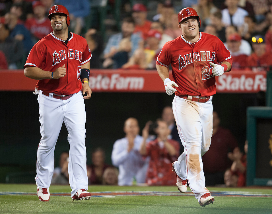 The Angels' Albert Pujols and Mike Trout jog to the dugout after scoring on a C.J. Cron double in the sixth inning Wednesday night at Angel Stadium.<br /> <br /> ///ADDITIONAL INFO:   <br /> <br /> angels.0616.kjs  ---  Photo by KEVIN SULLIVAN / Orange County Register  -- 6/15/16<br /> <br /> The Los Angeles Angels take on the Minnesota Twins Wednesday at Angel Stadium.
