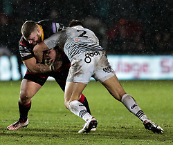 Dragons' Lloyd Fairbrother is tackled by Ospreys' Scott Baldwin<br /> <br /> Photographer Simon King/Replay Images<br /> <br /> Guinness Pro14 Round 12 - Dragons v Cardiff Blues - Sunday 31st December 2017 - Rodney Parade - Newport<br /> <br /> World Copyright © 2017 Replay Images. All rights reserved. info@replayimages.co.uk - http://replayimages.co.uk