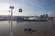 The southbound view from a gondola on a journey over the River Thames on the Emirates Cable Car, from Royal Docks towards the o2 arena on the Greenwich Peninsular. There are 34 gondolas, each with a maximum capacity of 10 passengers. The Emirates Air Line (also known as the Thames cable car) is a cable car link across the River Thames in London built with sponsorship from the airline Emirates. The service opened on 28 June 2012 and is operated by Transport for London. The service, announced in July 2010 and estimated to cost £60 million, comprises a 1-kilometre (0.62 mi) gondola line that crosses the Thames from the Greenwich Peninsula to the Royal Docks. ..