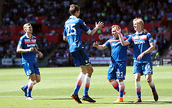 Stoke City's Peter Crouch (centre) celebrates scoring his side's second goal of the game with team-mates Xherdan Shaqiri and Lasse Sorenson (right) during the Premier League match at the Liberty Stadium, Swansea.