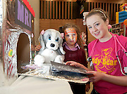 23/01/2014 Sad Sam with Hannah Kate Sherlock from Scoil Iognaid and Elaine Murphy 3rd year student from Kilmallock Co Limerick at Teddy Bear Hospital at NUI, Galway where Medical Students got used to dealing with Children and Kids get used to the Hospital procedures. Photo:Andrew Downes.
