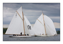 The Truant 1910 an 8 metre with Fyne a 1889  Gaff Cutter both off Cumbrae...The Round the Cumbraes race to open the regatta. Light variable breeze and grey skies shrouded the fleet with a strong spectator fleet...* The Fife Yachts are one of the world's most prestigious group of Classic .yachts and this will be the third private regatta following the success of the 98, .and 03 events.  .A pilgrimage to their birthplace of these historic yachts, the 'Stradivarius' of .sail, from Scotland's pre-eminent yacht designer and builder, William Fife III, .on the Clyde 20th -27th June.   . ..More information is available on the website: www.fiferegatta.com . .Press office contact: 01475 689100         Lynda Melvin or Paul Jeffes