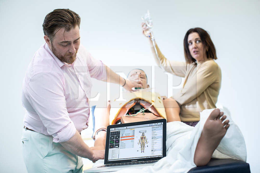 © Licensed to London News Pictures. 10/07/2019. Manchester, UK. Staff test a hi-tech programmable METIman medical training mannekin, which will be used to test the skills of doctors at the new facility. General Medical Council (GMC) staff prepare for the opening of the regulator's new test facility in central Manchester. The £2.5m clinical assessment centre in the city's Spinningfields district will assess the skills of overseas-trained doctors who want to work in the UK. Once it opens in early August, more than 1,000 doctors per month will undergo a series of practical tests to show they have the skills required for a licence to practise medicine in the UK. It will replace the GMC's existing test centre, which has a more limited capacity. Photo credit: Joel Goodman/LNP