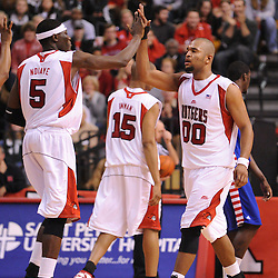 Jan 31, 2009; Piscataway, NJ, USA; Rutgers center Hamady N'Diaye (5) high fives teammate forward Gregory Echenique (00) after the later scored a big basket during the second half of Rutgers' 75-56 victory over DePaul in NCAA college basketball at the Louis Brown Athletic Center
