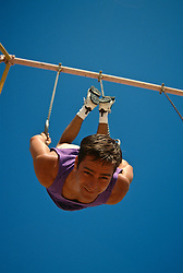 Close up of a man on gymnastic rings