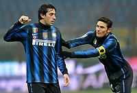 Diego Milito e Javier Zanetti (Inter) festeggiano<br /> Inter Bologna - Campionato di Seire A Tim 2010-2011<br /> Stadio Giuseppe Meazza, San Siro, Milano, 15/01/2011<br /> © Giorgio Perottino / Insidefoto