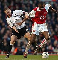 Photo. Javier Garcia<br />01/02/2003 Arsenal v Fulham, FA Barclaycard Premiership, Highbury<br />Sean Davis gets to grips with Patrick Vieira