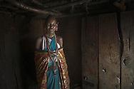 Maasai woman in traditional garb, Masai Mara, Kenya.