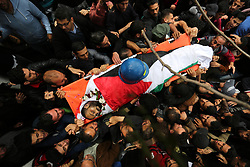 April 26, 2018 - Jabalia, Gaza Strip, Palestinian Territory - Mourners carry the body of Palestinian journalist Ahmed Abu Hussein, 24, who was died of his injuries sustained by Israeli security forces as he was covering demonstrations on the Gaza border since two weeks ago, during his funeral in Jabalia, in the northern of Gaza Strip, on April 26, 2018  (Credit Image: © Ashraf Amra/APA Images via ZUMA Wire)