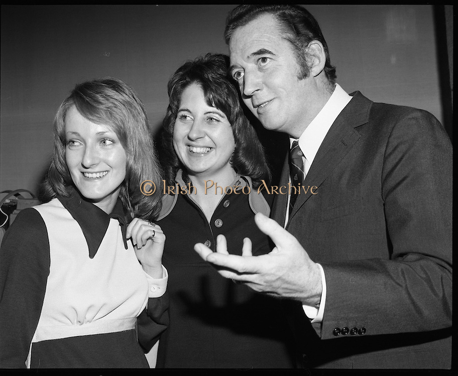 Classified Telephone Girl of the Year..1972..18.12.1972..12.18.1972..18th December 1972..The Area Final Ireland of the Classified telephone Girl of the year 72/73 was held in the Telecommunications Centre, Booterstown Ave. The winner will go forward to the next round at The Grand Hotel,Manchester in February next..The competition was organised by The Irish Times..The contestants were:.Ms Kathy Bannon, Farming Life, Belfast..Ms Carol Budd, Evening Herald,Dublin..Ms Dorothy Gough,Irish Field,Dublin..Ms Linda Hanna,News Letter,Belfast..Ms Susan Harrigan,Sunday News,Belfast..Ms Sophie Kelleher,The Cork Examiner..Ms Marie O'Callaghan,Evening Echo,Cork..Ms Bernadette O'Neill,Irish Independent,Dublin..Ms Rose O'Riordan,Irish Times,Dublin..Ms Pat O'Connell,Belfast Telegraph...Picture of Ms Marie O'Callaghan (Evening Echo) and Ms Sophie Kelleher(Cork Examiner) being instructed in the studio arrangements by compere,Mr Bunny Carr.